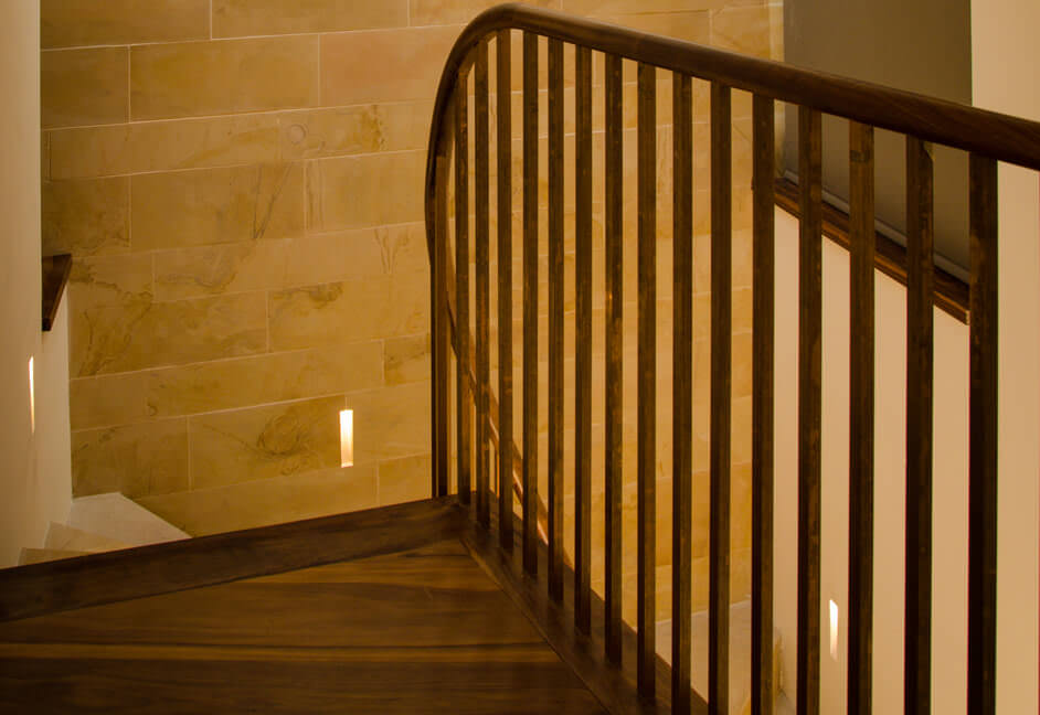 Staircase lighting with stone clad walls with plaster in Brick In The Wall orientation Stripp lighting
