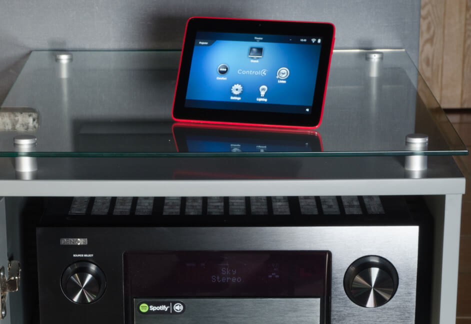 Control 4 wireless touch panel on top of AV Rack for home cinema demo room in South West England