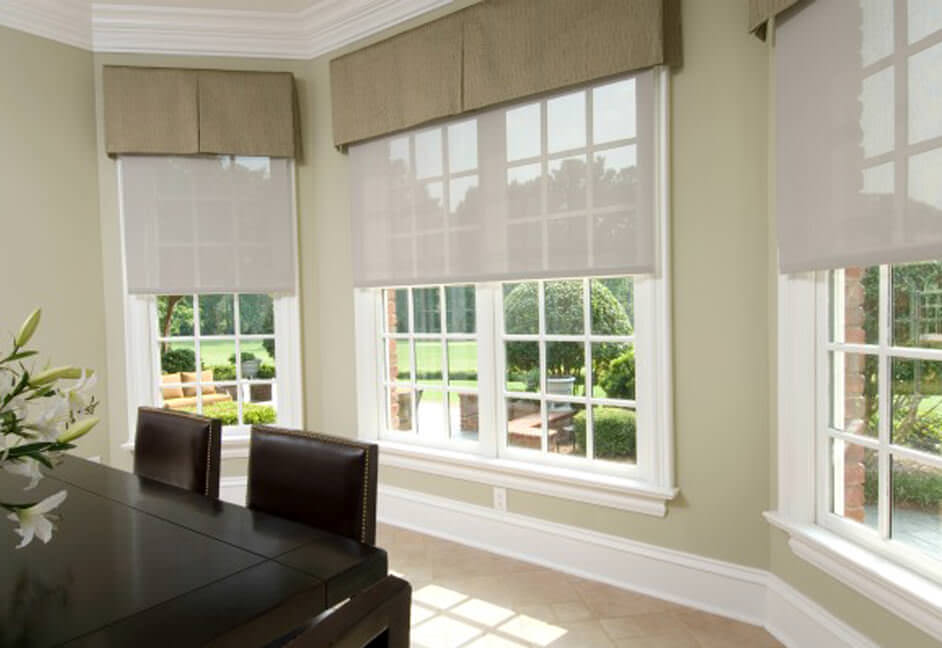 Dining room with large windows looking over garden with home automated blinds and shading control