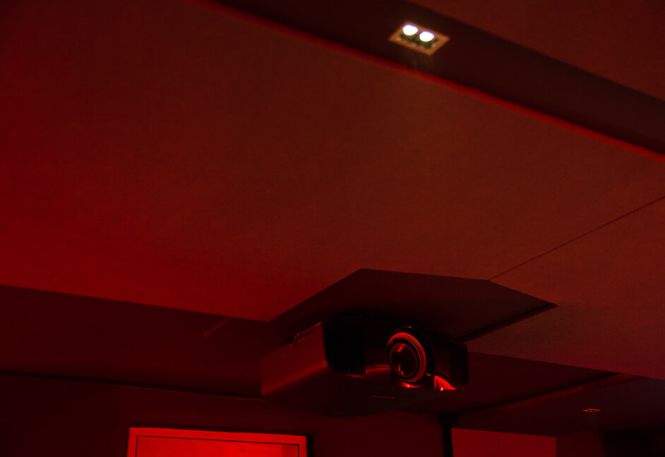Ceiling mounted projector in media room in London