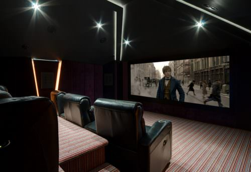 Bespoke home cinema media room installation in England with cinema seating, dolby atmos, lighting control and whole home audio visual solutions