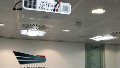 Ceiling mounted projector installed meeting room