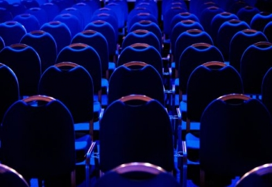 empty corporate conference seating lit with blue preset lighting state