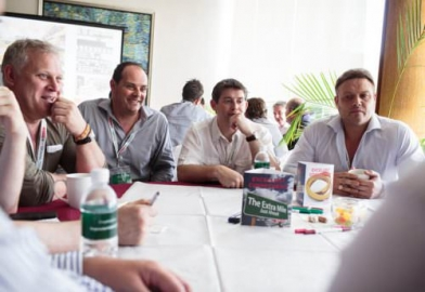 Attendees of a breakout session around a table