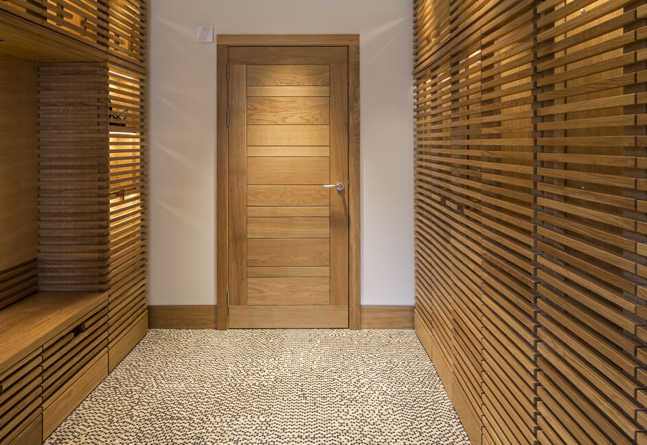 Boot Room with bespoke cupboard detail lighting and general downlighting for private residence in Scotland