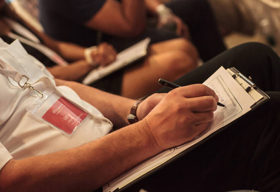 Delegate taking notes at a conference