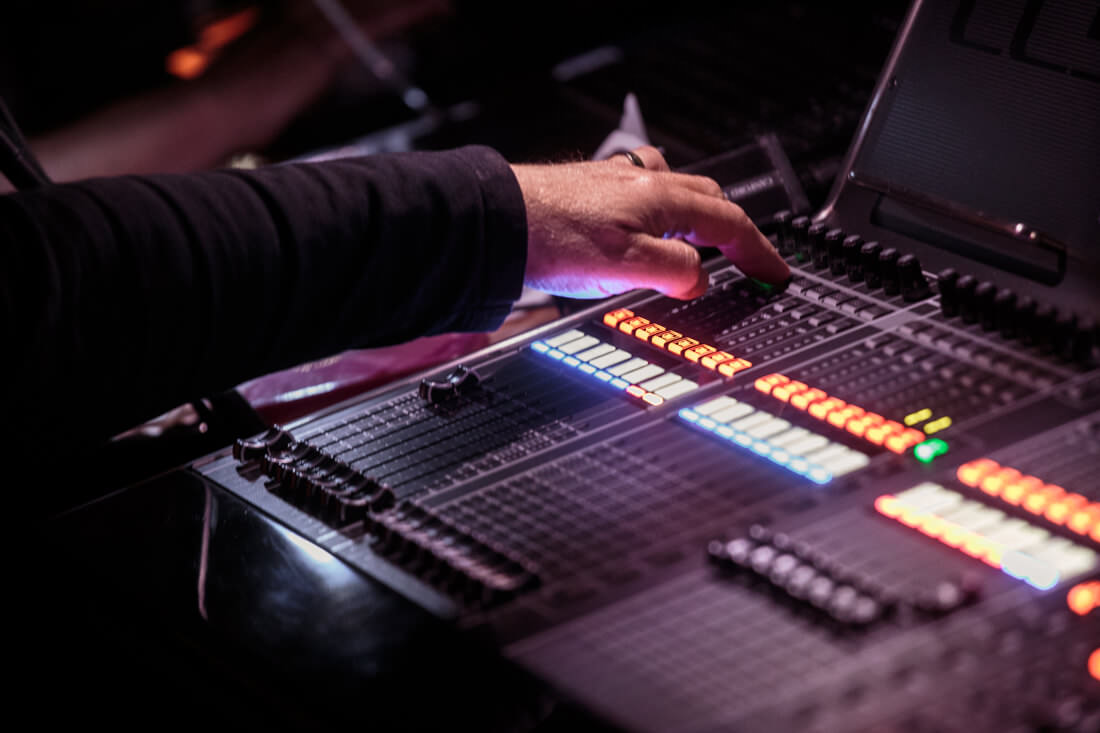 Event production using a mixing desk to control lighting and audio
