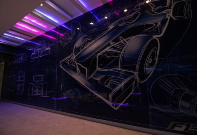 Racing car feature wall lighting in entertainment leisure space