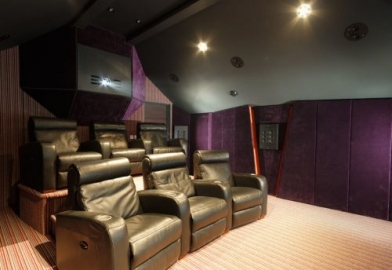 Curved cinema seating in home cinema as part of whole home control system near London
