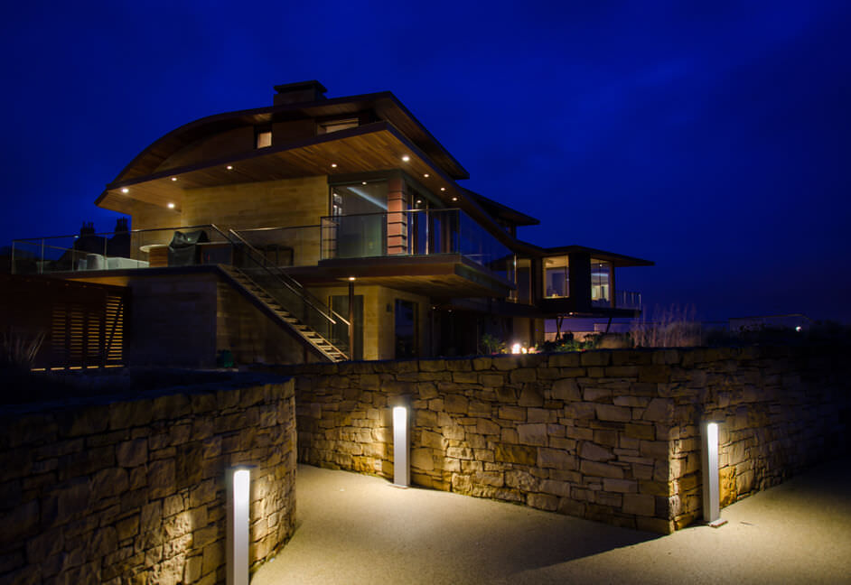 Delaltight bollard Oblix and Flipset lighting in gardens and landscaped areas in holiday property in Scotland