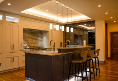 Kitchen lighting in luxury home in Scotland with Photonstar colour tuneable downlights, over island pendants, kicker lighting, cupboard lighting, DALI controllable, wireless lighting control