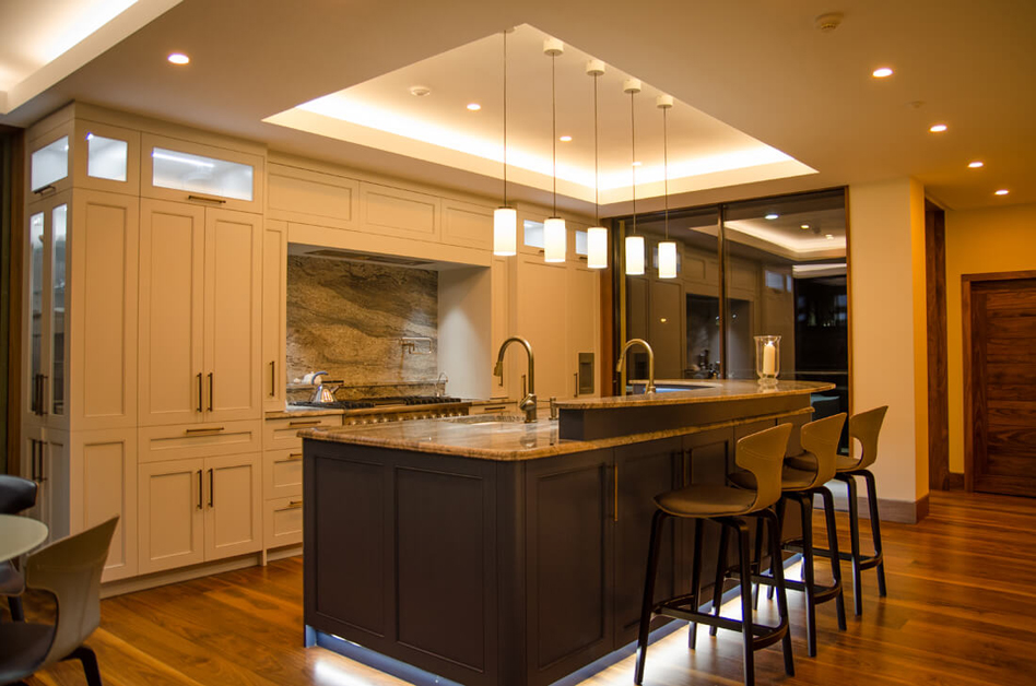 Kitchen lighting including pendants, colour tuneable downlights, colour tuneable cove coffer lighting, kicker counter lighting and cupboard lighting