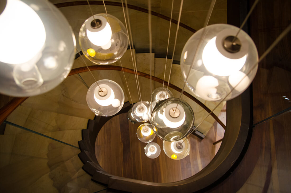 Feature pendants hanging in central entrance lobby staircase