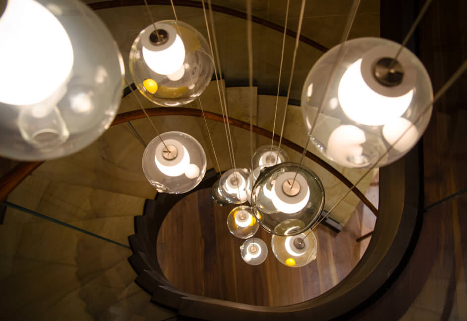Staircase drop down feature pendent light