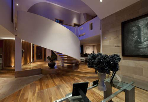 Spiral staircase in large family home in Scotland with colour changing LED lighting under hand rails