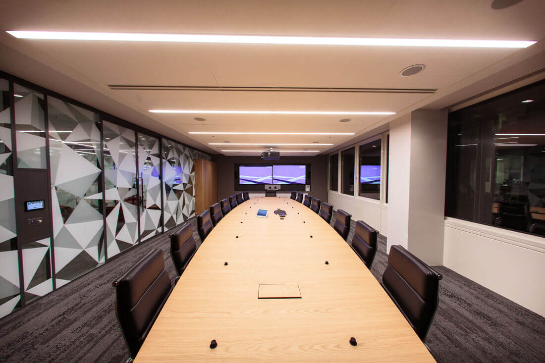 QBE Insurance London Boardroom with two tv screens on show