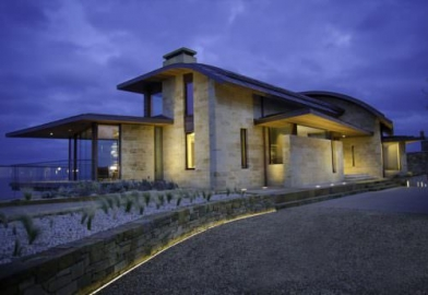 External view of large luxury property with internal and external lighting controlled by Rako, Pharos and Control 4