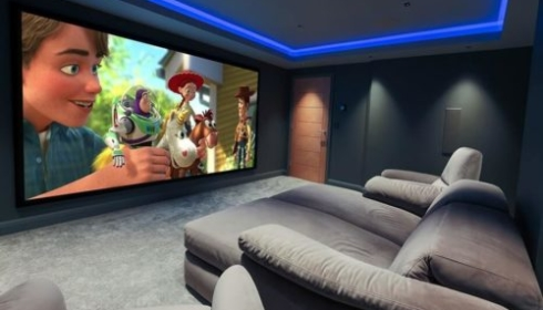 Gaming and media room with Toy Story on screen