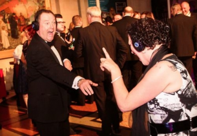Delegates of awards dinner at a silent disco in Bristol Museum and Arts Gallery