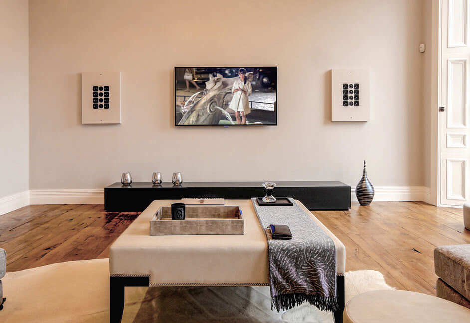 Artcoustic speakers wall mounted in a home living room lounge sitting room
