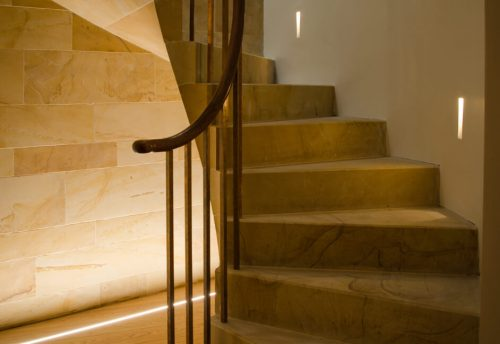 Brick In The Wall Stripp plaster-in lighting and KKDC Mimi inground lighting in staircase and stairwell in house in Scotland