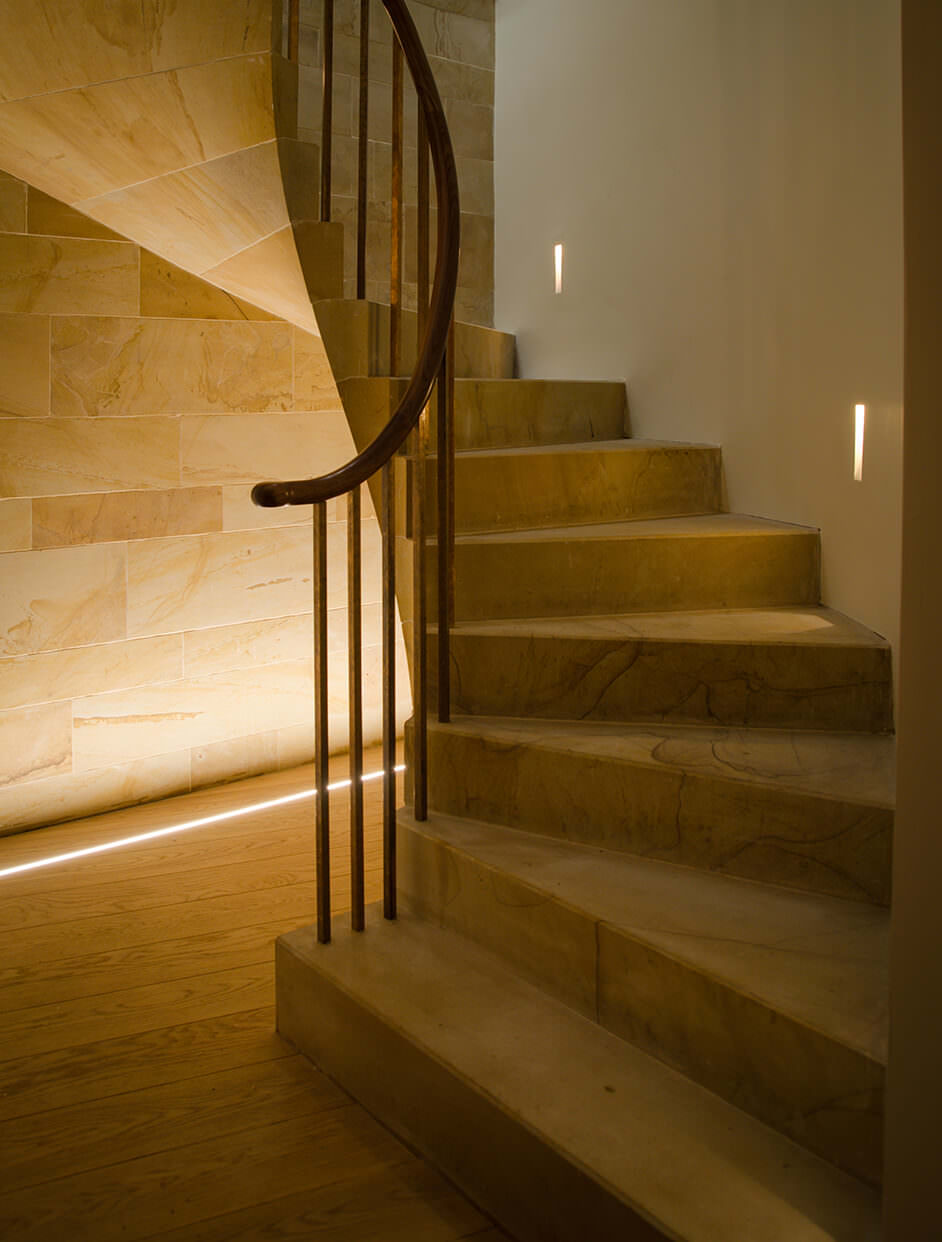 Stone staircase with inground uplighter wall washer with unwell detail lighting in a luxury home in Scotland