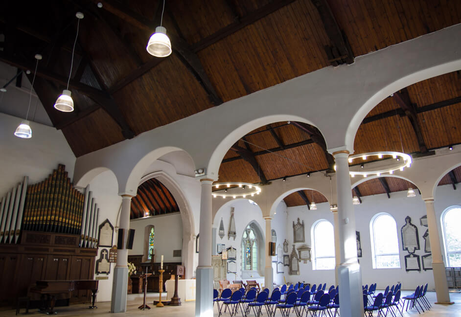 Stoke Damerel Church lighting with Fagerhult track mounted spotlights and Dino pendant fittings with bespoke chandeliers from Spectral Lighting and Ridi Lighting all controlled via Rako Controls