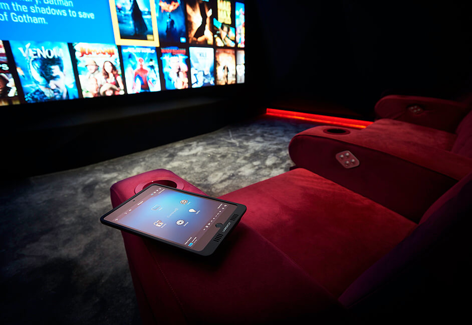 close up of home cinema touch control with kaleidescape and control 4