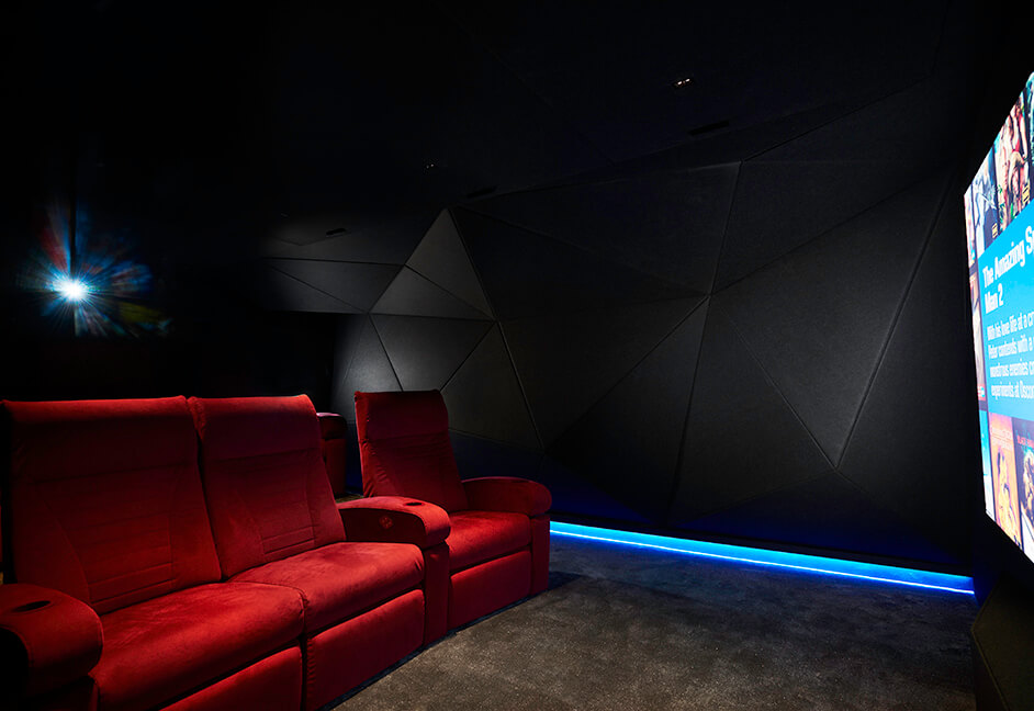 luxury private cinema design with red seating and skirting LED lighting