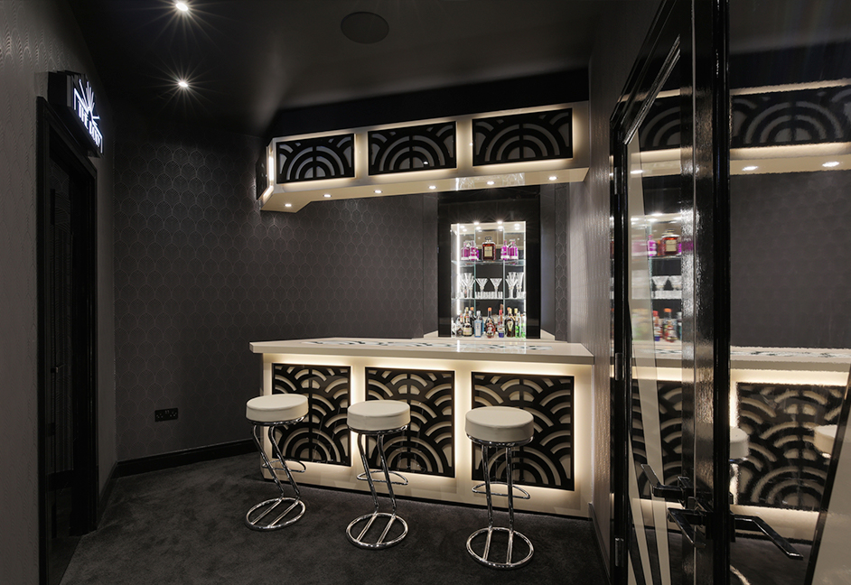 bar area with ceiling speakers and lighting