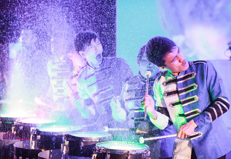 Opening act of performers doing water drumming
